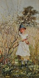 Young girl picking spring blossom